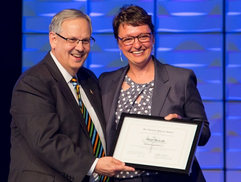 Bishop Bruce Ough presents the Francis Asbury Award to Amy Novak at the Dakotas Annual Conference. Photo credit: Joni Rasmussen