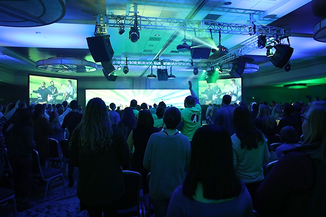 Participants join in worship at Exploration