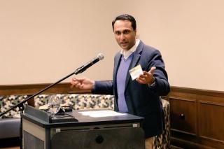 Eboo Patel speaking at a podium