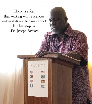 Dr. Joseph Reeves, director of advising and counseling assistant professor, Philosophy and Religion at the University of Liberia, encourages participants to draw upon their own personal stories in their writing at an AAUMTI writers workshop this summer