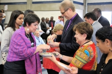 Bishop Kenneth Carter and Rev. Dr. Kim Cape serve communion during closing worship