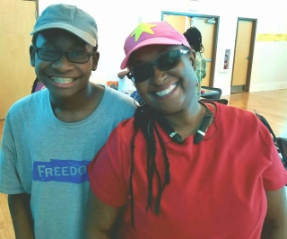 (L) Eighth grader Trey, a scholar at the 2017 Freedom School  at Gordon Memorial United Methodist Church, learned lessons in cultural  pride, confronting bullying, and being his best self, says his mom (R).